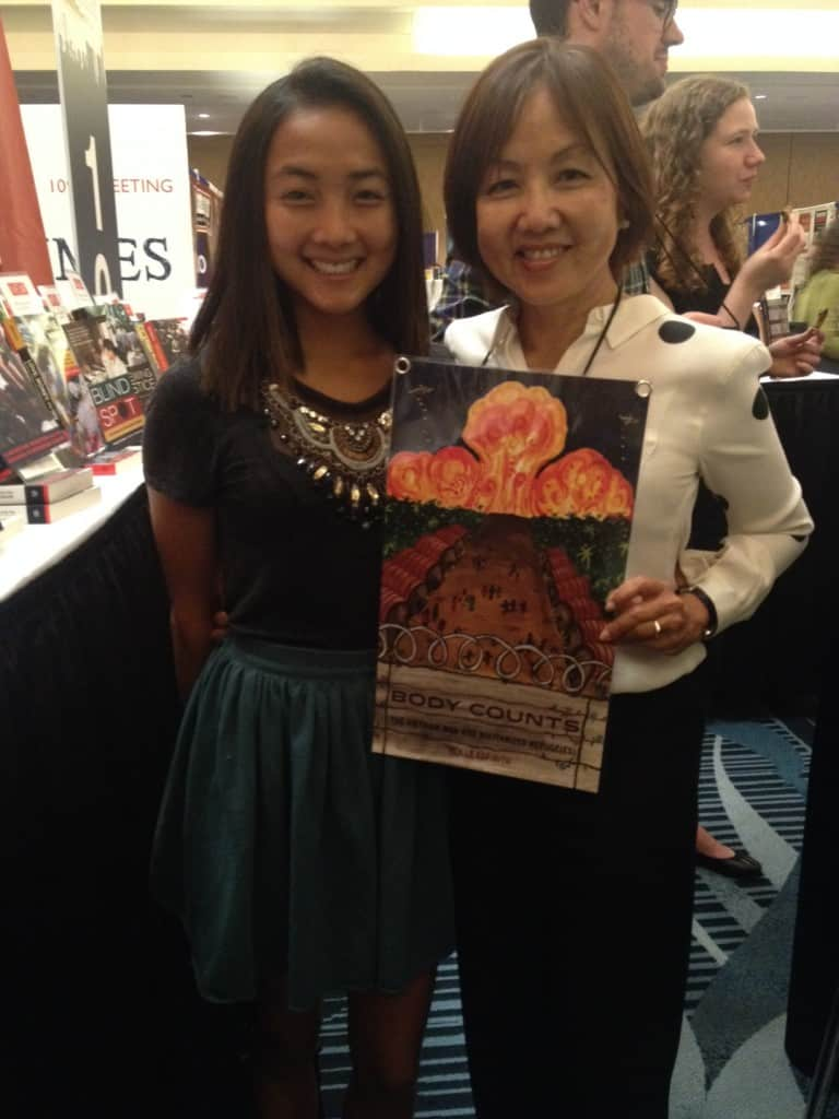 Yen Le Espiritu (R) with her new book, Body Counts: The Vietnam War and Militarized Refugees, and her daughter Maya, who designed the cover