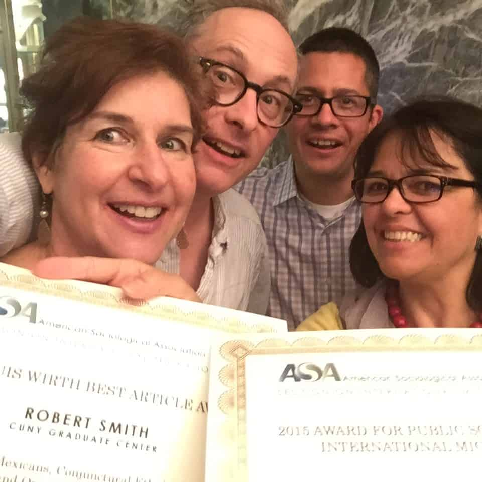 Rob Smith and Cecilia Menjivar with their respective awards, along with author Roberto Gonzales and Sociology editor Naomi Schneider.