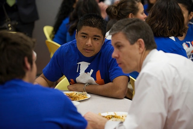 Former U.S. Secretary of Education Arne Duncan with Reality Changers students.