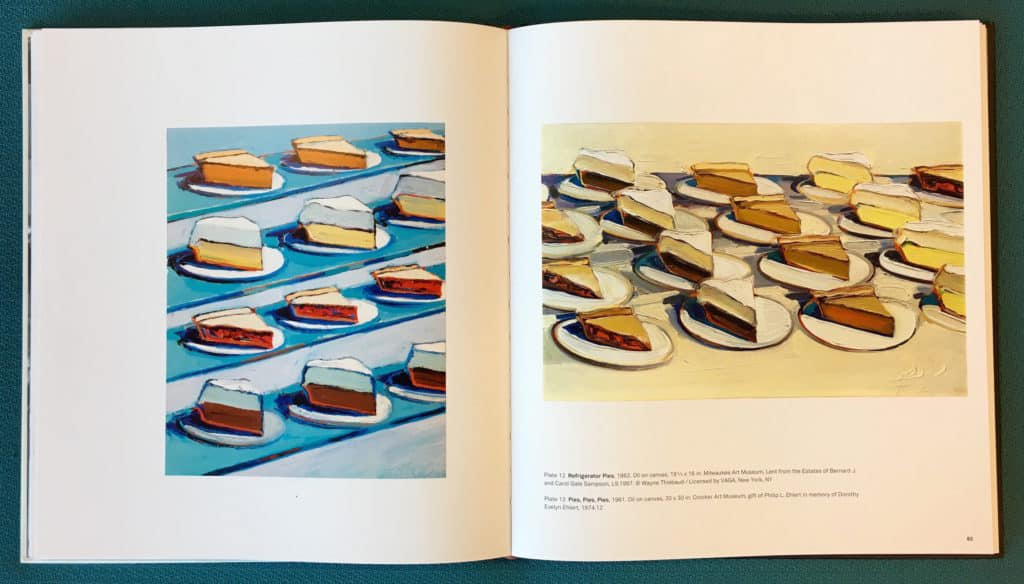 Photo of internal catalogue spread featuring paintings by Wayne Thiebaud