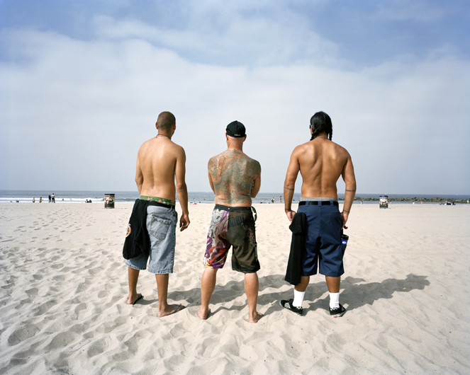 <p>Three surfers viewing wave conditions. Venice Beach, 2008.</p>