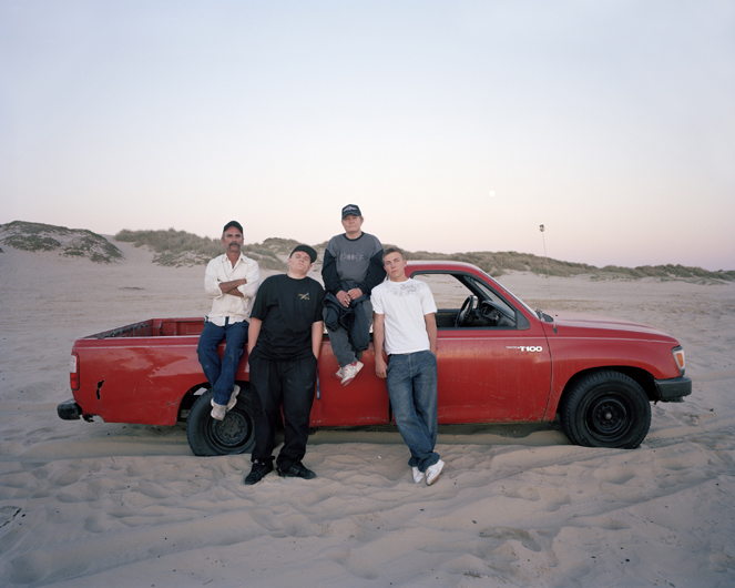 <p>Family and their little red truck on beach. Pismo Beach, 2007.</p>