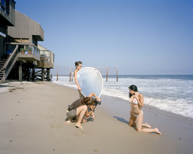 <p>Photo shoot for a mobile phone advertisement; a controversial fence restricting beach access stands in the background. Malibu Beach, 2007.</p>