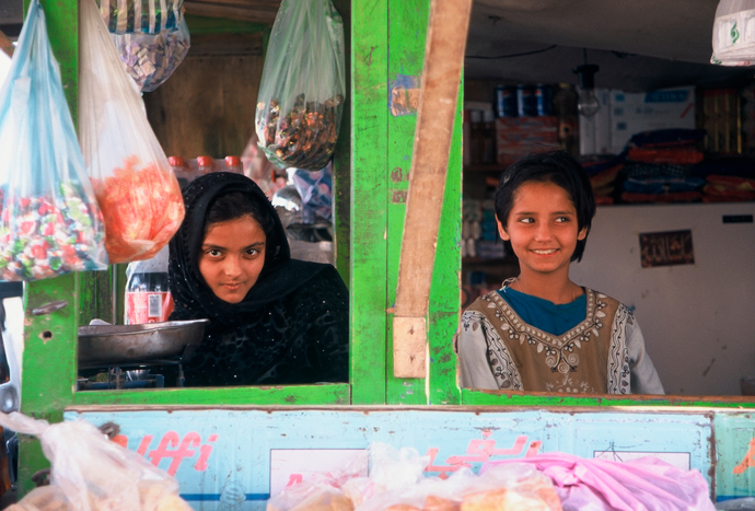 <p>Fig 14: Two girls pose in a candy shop in Kabul. <br />Photo by Sheryl B. Shapiro, 2003</p>