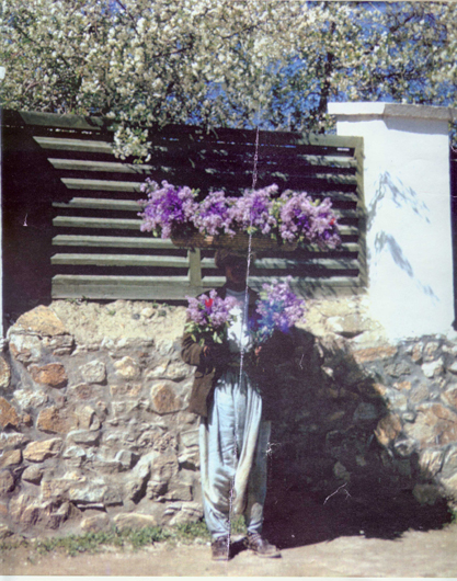 <p>Fig. 3: A young man sells lilacs outside the author&rsquo;s Kabul home. <br />Courtesy of Jennifer Heath, 1965.</p>
