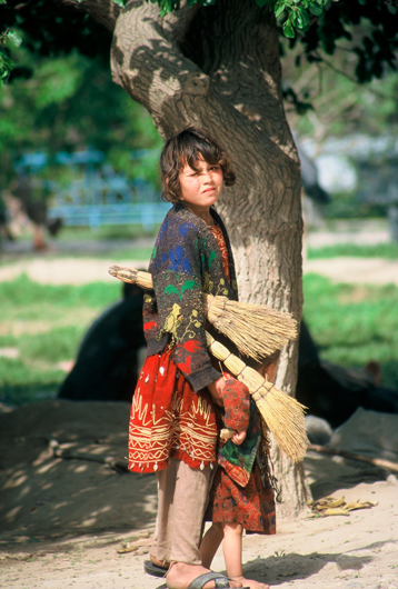 <p>Fig. 4: Two small girls sweep sidewalks in Kabul. They are among thousands of Afghan children who must work to help support their families. <br />Photo by Sheryl B. Shapiro, 2003.</p>