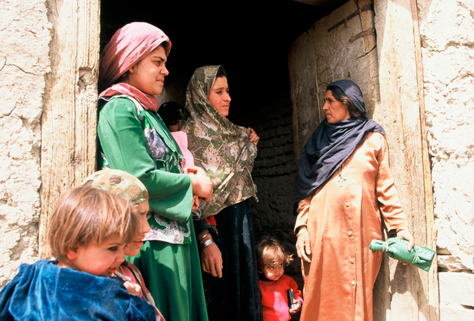 <p>Fig. 6: Women and their children in the farming village of Bustan, Afghanistan.<br />Photo by Sheryl B. Shapiro, 2003.</p>
