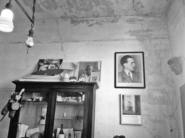 <p>Back office with photograph of Marcel Duchamp on the wall, 2007</p>