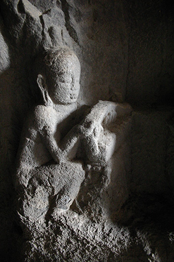 <h2><strong>All photos by author unless otherwise specified.</strong></h2> <h2>&nbsp;</h2> <p>Web 1-1 Monk holding a book, detail of the Mahāmāyūrī panel, Cave 10, Ellora, ca. 7th century.</p>