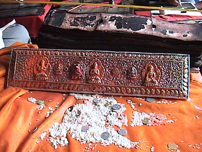 <p>Web 2-3 Sculpted cover of an AsP Ms in worship during restoration of the manuscript, Patan, Nepal. July 19, 2004.</p>