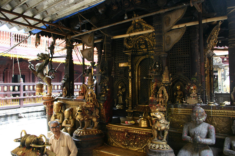 <p>Web 7-7 Front part of the lineage deity shrine in the center of the courtyard with sculptural and decorative additions from different times, Kwā Bāhā, Patan, Nepal.</p>