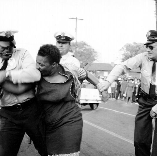 <p>Unidentified photographer, <em>Woman Resisting Arrest</em>, Birmingham, Alabama, April 14, 1963. Courtesy of Michael Ochs Archives/Getty Images.</p>