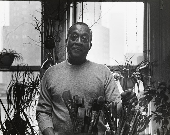 <p>Norman Lewis in the studio<br /> Photo: Budd<br /> Estate of Norman W. Lewis; Courtesy of Michael Rosenfeld Gallery, New York</p>