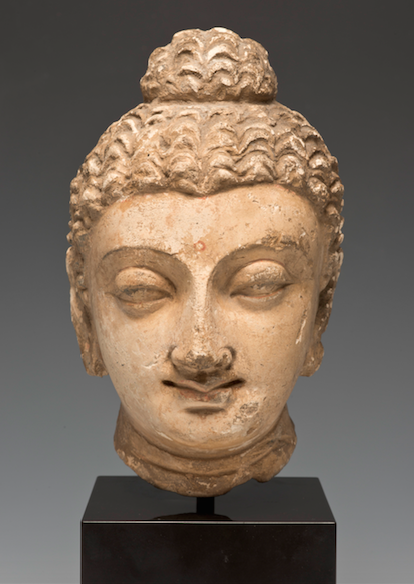 <p><em>Head of Buddha with Prominent Topknot</em>, Ancient Gandhara, present-day Pakistan, 4th&ndash;5th century. Stucco with traces of color. Santa Barbara Museum of Art, Anonymous Gift.</p>