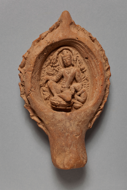<p><em>Lamp-shaped Votive Plaque</em>, India, Bihar, 9th century. Terracotta. Santa Barbara Museum of Art, Gift of Stephen P. Huyler.</p>